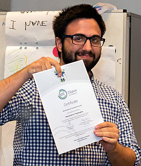 Alexandros Toptsoglou receiving his Summer School certificate (Digital Finance - Economics of Blockchain Security in Budapest).