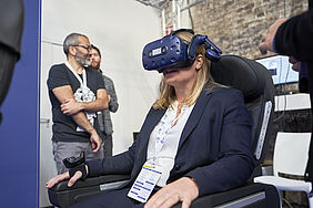 Sitting on a real airplane seat, users wore a headset to interact with a VR-immersive environment simulating the fuselage of an airplane.